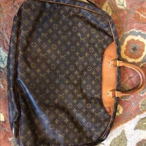 LV carry on garment bag